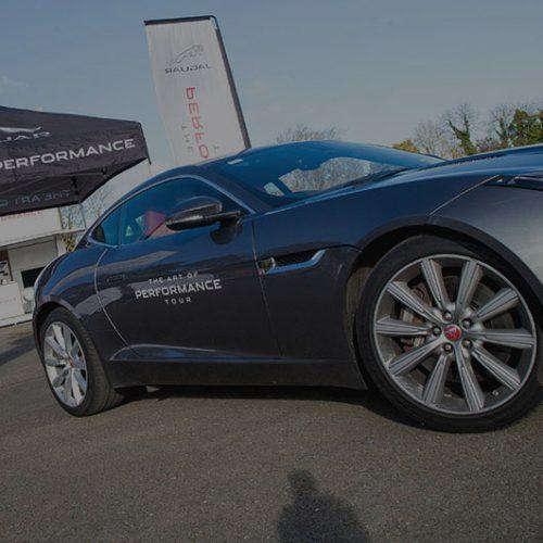 A jaguar car parked up at an automotive launch.