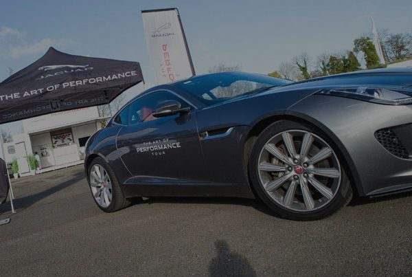 A jaguar car parked up at an automotive launch.