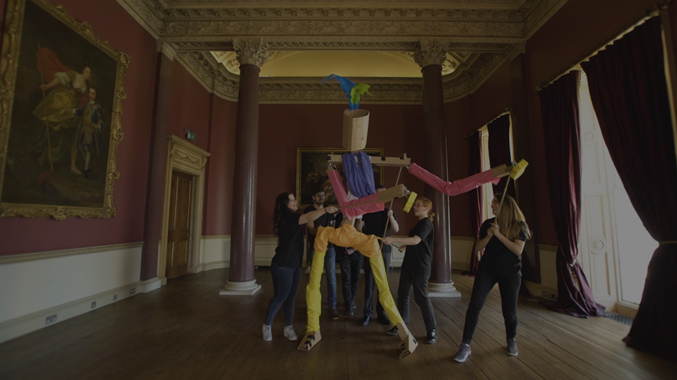 Delegates manipulating a gigantic puppet they built during a team-building activity in the Drawing Room of Carton House.