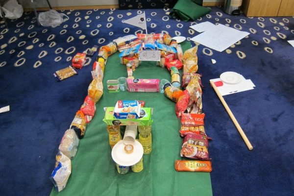 A sustainable pitch and putt course built out of household materials during an Orangeworks charity team building activity.