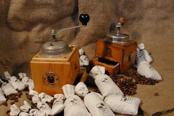 Coffee beans and grinders laid out for the team building exercise 'Bean Around the World' with Orangeworks.