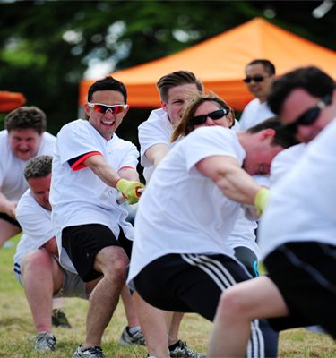 Delegates playing tug of war during Corporate Sports Day with Orangeworks