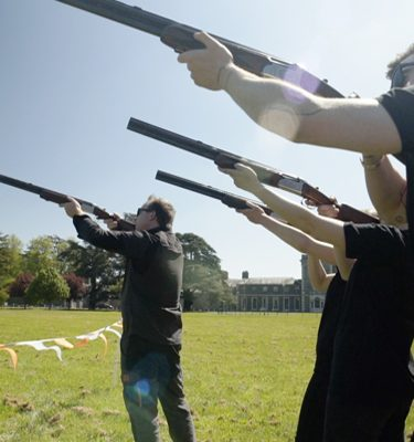 Delegates holding laser clay pigeon guns as they take part in Orangeworks Laser Clay Pigeon Shooting.