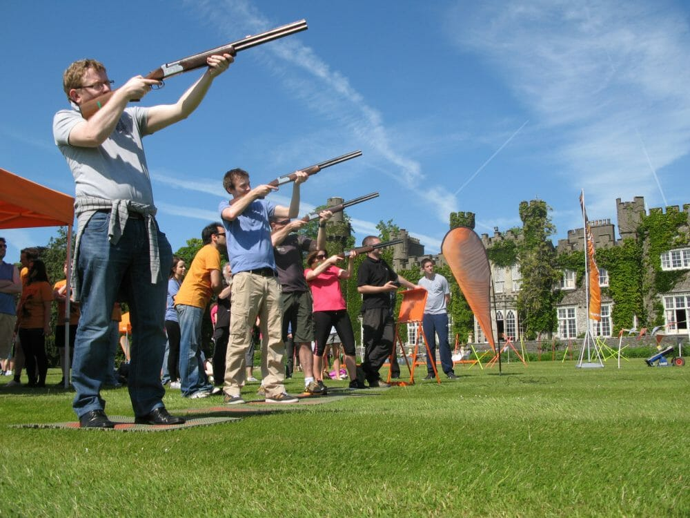 People learning how to clay pigeon shoot with Orangeworks in Luttrellstown Castle.