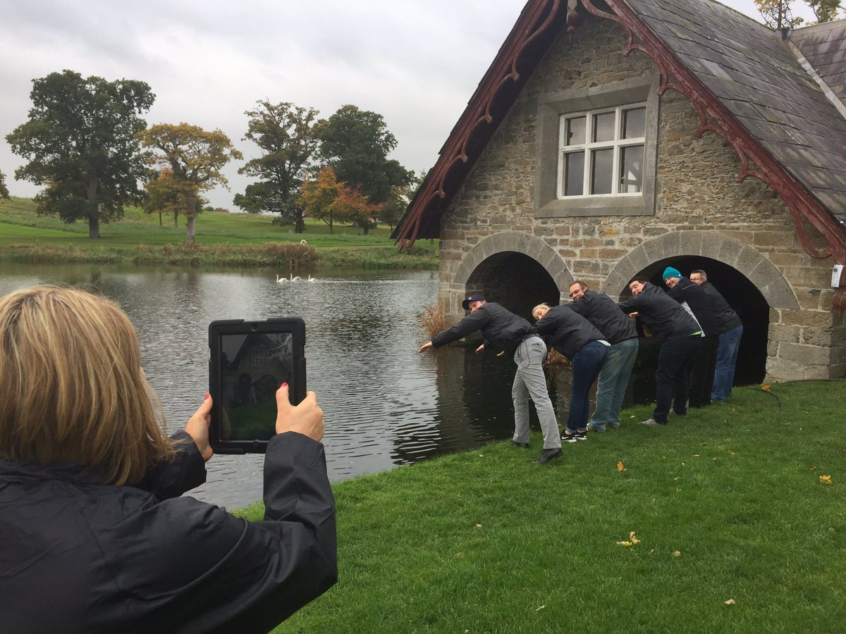 Delegates pretending to jump into the river at the Boat House in the K Club during their team building treasure hunt.