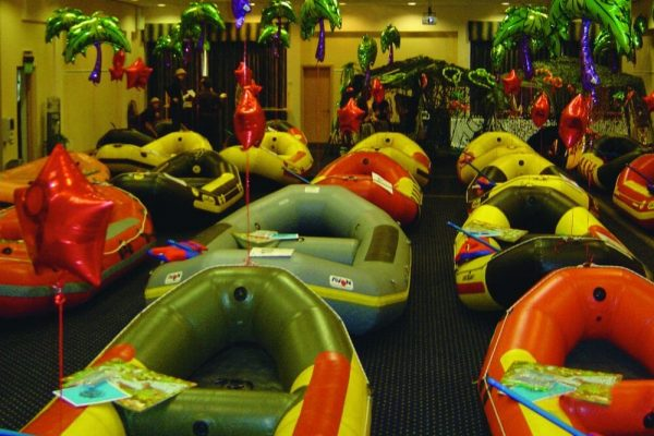 The Orangeworks team building game River Runner, set up for the delegates with blow-up boats, paddles and palm trees.