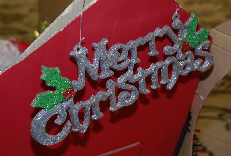A Merry Christmas sign hung on Santa's sleigh that delegates built during their Christmas themed activity.