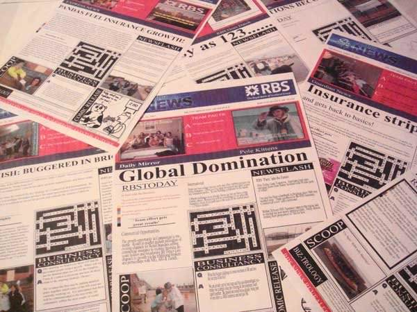 Newspapers laid on a table, during the team bonding activity called Making the News by Orangeworks.