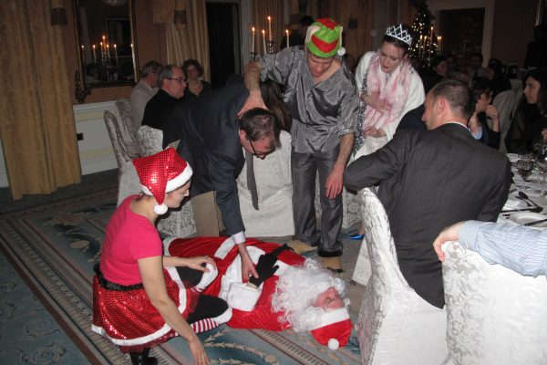 Teams gathered around Santa during the team bonding christmas themed challenge hosted by Orangeworks.