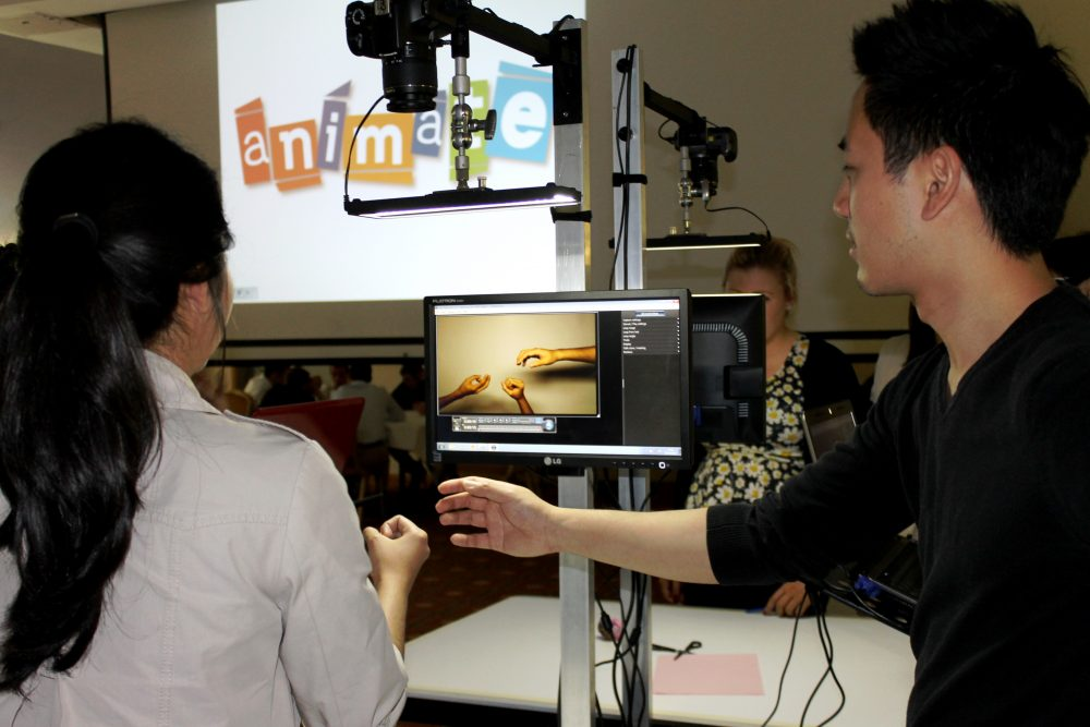 Teams begin creating their animation background during Animate - a stop motion animation activity brought to you by Orangeworks.
