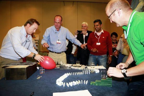Delegates enjoying Domino Effect, a fun, energetic team challenge powered by Orangeworks.