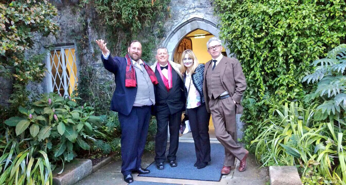 Actors of Orangeworks murder mystery game ready to greet guests as they arrive for their corporate evening entertainment.