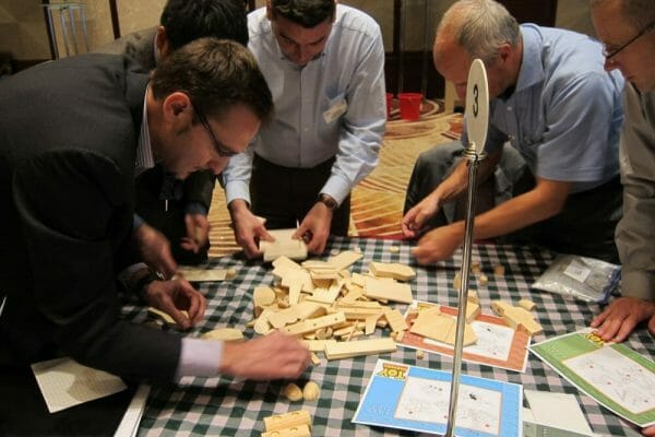 Delegates building their wooden toy cars during their corporate team bonding experience with Orangeworks.