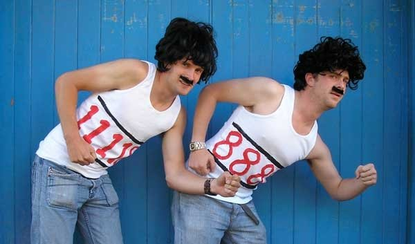 Two guys dressed up as the 888 guys for the team building activity Commercial Break by Orangeworks.