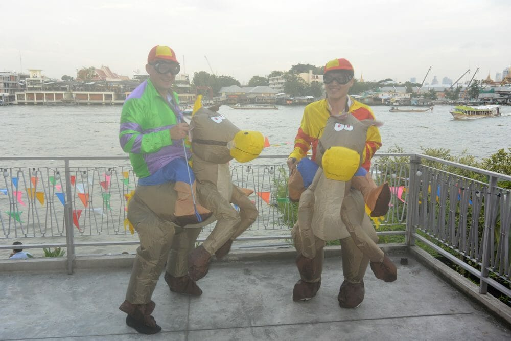 Two delegates dressed in horse costumes for their Orangeworks team building event.