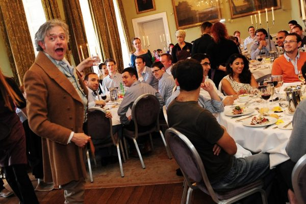 Rob, an Orangeworks actor interacting with guests during their 1916 Murder Mystery themed corporate evening dinner.
