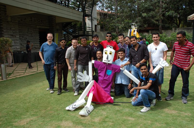 Delegates smiling with their completed puppet during Puppet Masters team building event by Orangeworks.