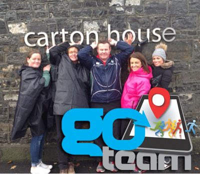 team members enjoying the photo challenge as part of Orangeworks Go Team Treasure Hunt at Carton House Kildare