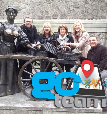 Delegates smiling with Molly Malone during Go Team Dublin Treasure Hunt