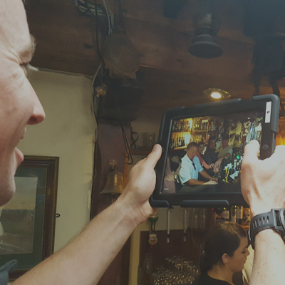 Delegates smile as they film their very own commercial in an Irish pub, as part of their corporate team bonding outings.
