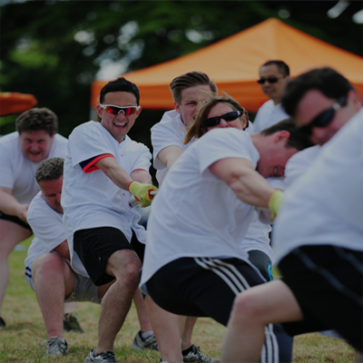 Delegates playing tug of war during a corporate sports day with Orangeworks.