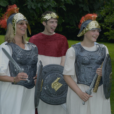 Delegates wearing gladiator outfits, laughing whilst filming for Fifteen Famous Minutes, a fun Team Building Exercise.