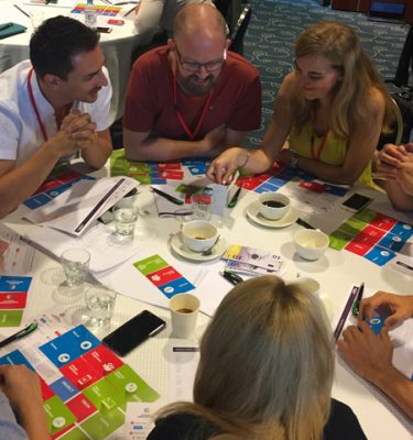 Delegates discussing ideas in Global Innovation Game event