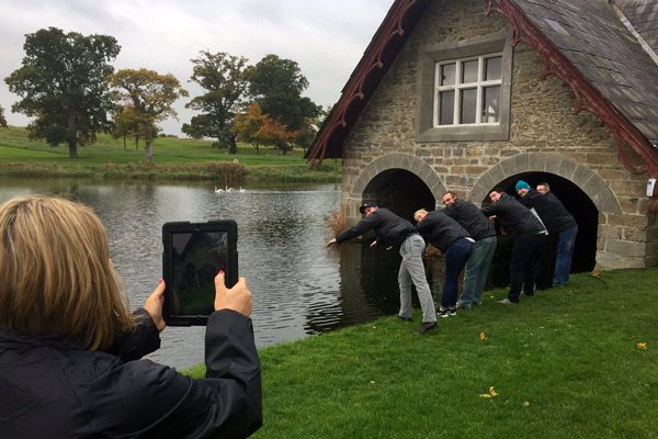 Delegates getting a picture pretending to dive into the river at the K Club, during their treasure hunt with Orangeworks.