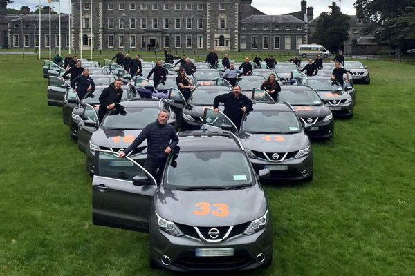 Orangeworks teams with Advantage DMC- Nissan Qasqui's on the grass outside Carton House Hotel