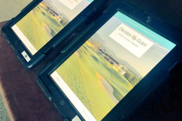Two iPads with Druids Glen Resort image and logo on screen