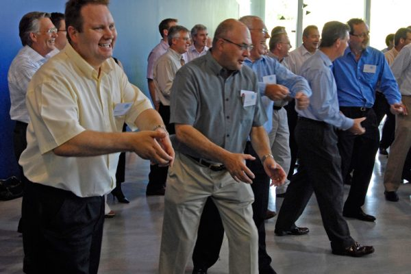 Delegates of One Voice, one of Orangeworks conference energisers, getting into the zone combining their dance moves with vocals.