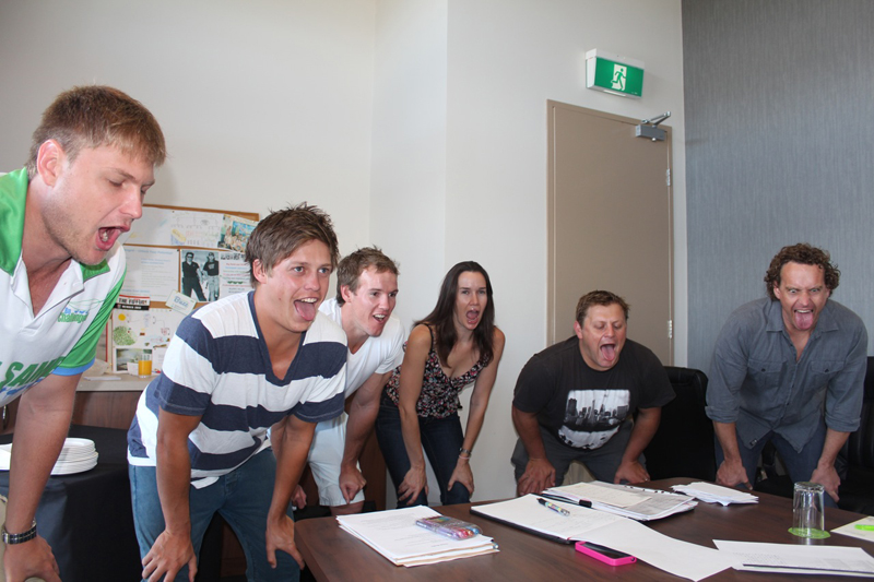 Delegates bending over with there tongues out as they learn some mindfulness and wellness techniques to practice.