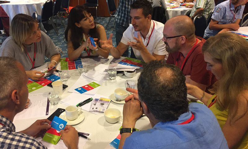 Team discussing ideas in Global Innovation Game