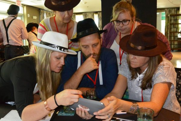 Delegates working together on an Escape the Mob challenge on their iPad