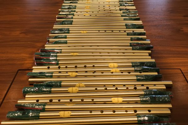 Tin whistles laid out of table for Irish TradFest