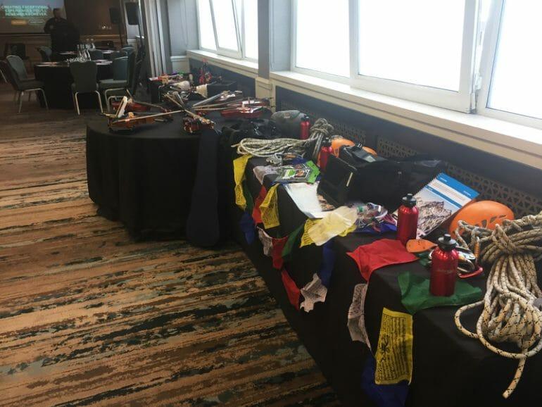 Peak Performance and Crescendo equipment set up on a table at Orangeworks Team Development Showcase.