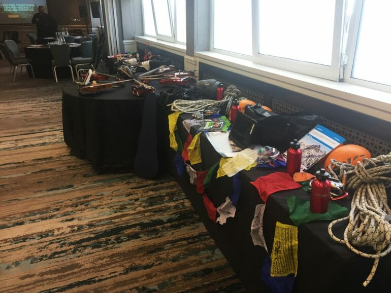 Peak Performance and Crescendo equipment set up on a table at Orangeworks Team Development Showcase.