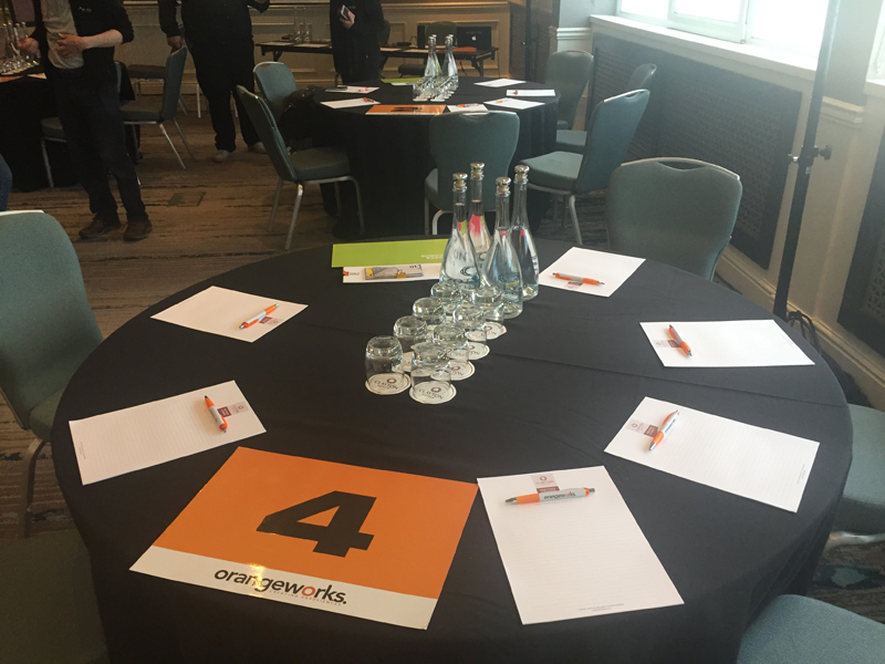 Tables set up and ready for delegates to arrive at Orangeworks Team Development Showcase