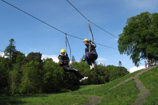 Two delegates on the zip line at Orangeworks adventure zone at Carton House.