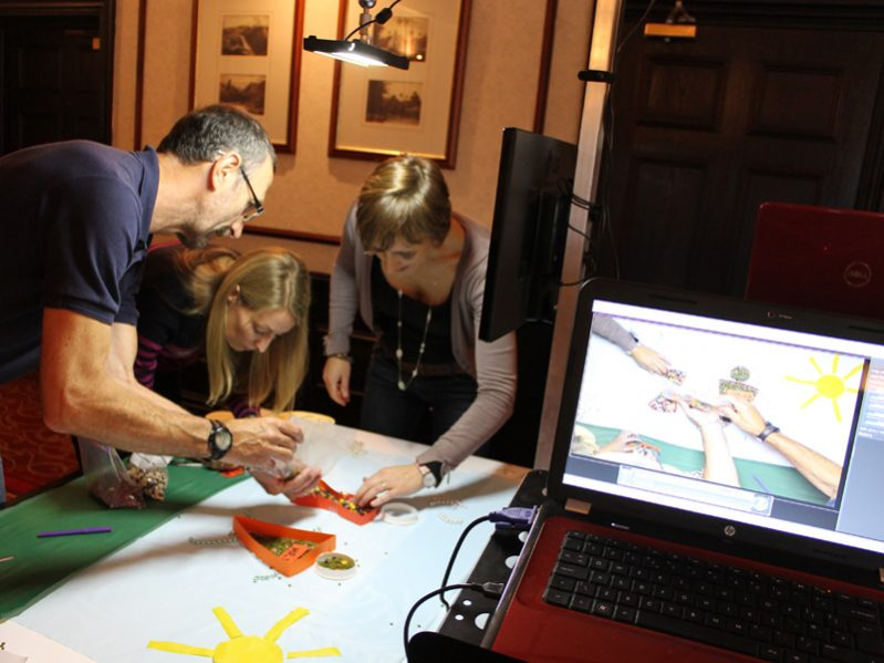 Delegates of one of Orangeworks creative team building activities called Animate, working together to create their animation