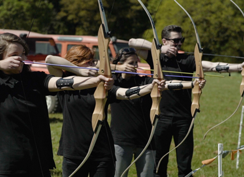 Participants taking part in archery during Irish themed Duke of Leinster Games by Orangeworks.