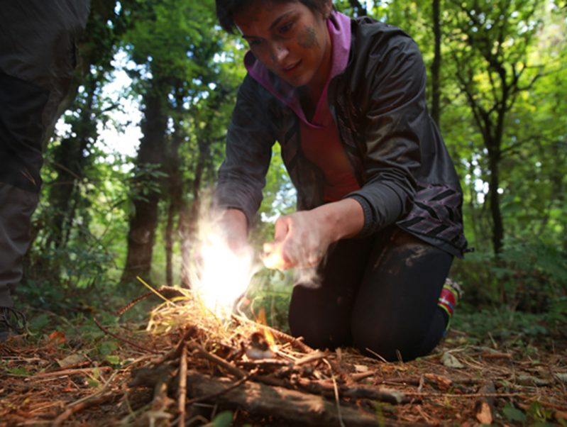 Delegate lighting her own fire which she learned how to do during the Bushcraft survival with Orangeworks.