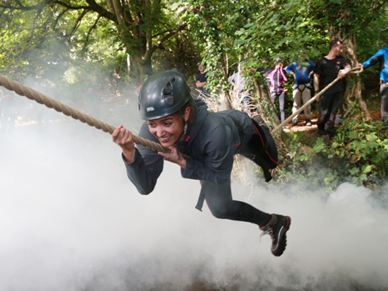 Delegate taking part in our rope tyrolean crossing above water during our survival course-Bear Grylls Survival Academy