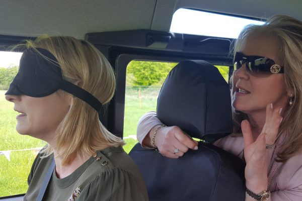 Delegate guided a blindfolded driver on how to drive the 4x4 blindfold driving obstacle course with Orangeworks.