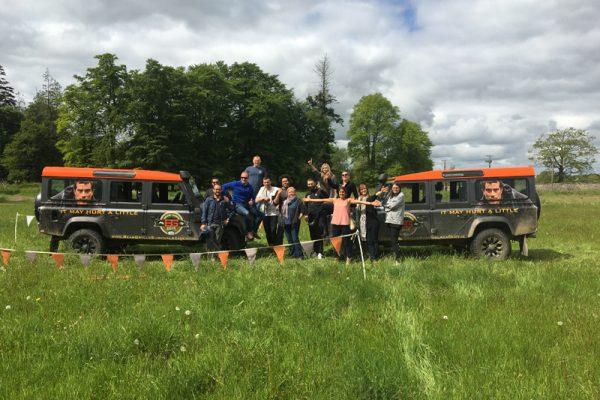 Delegates smiling with Orangeworks Land Rover Defender before Blindfold Driving