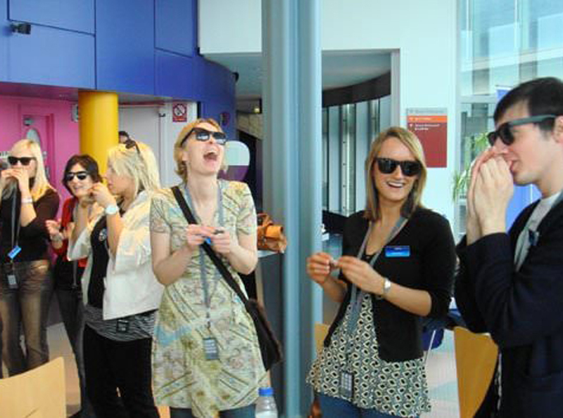 Delegates clapping and dancing as they listen to the harmonica being played during the Orangeworks team bonding activity.