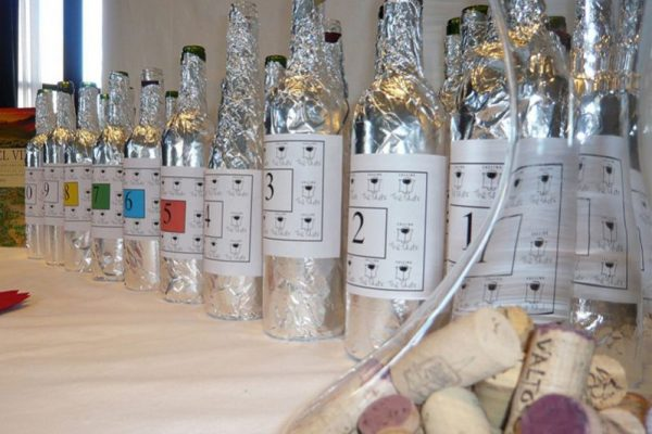 Unbranded wine bottles ready for Calling the Shots, a corporate evening interaction hosted by Orangeworks.