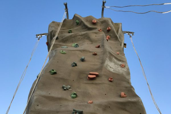 Mobile Climbing Wall from down below on a blue sky day