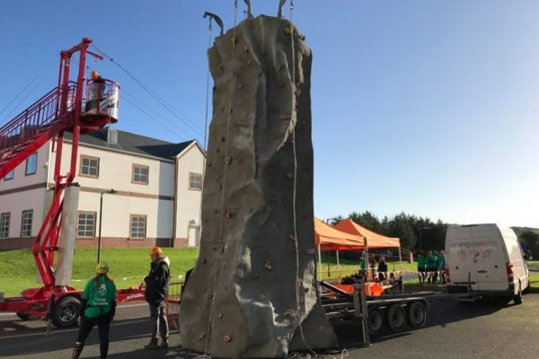 Orangeworks Mobile Climbing Wall and zip line being set up for an event