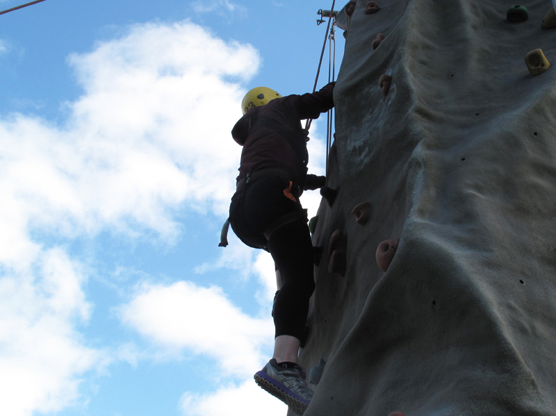 Delegate climbing Orangeworks Mobile Climbing Wall at their corporate staff day out.